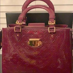 Louis Vuitton Epi Leather in Burgundy